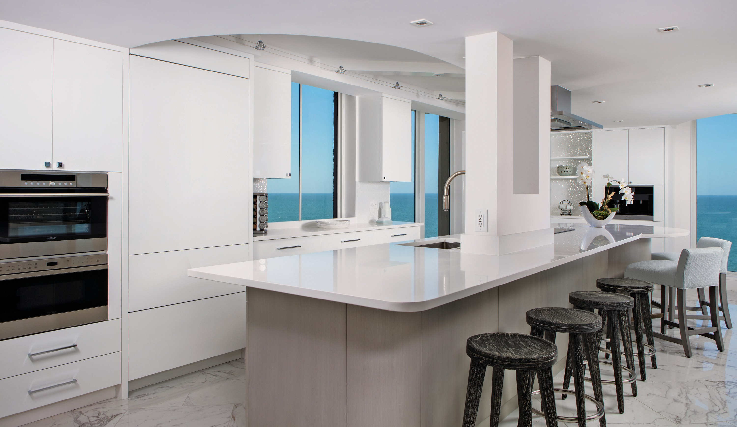 This gulf-front condo in Surfsedge was dated, dark and compartmentalized. London Bay